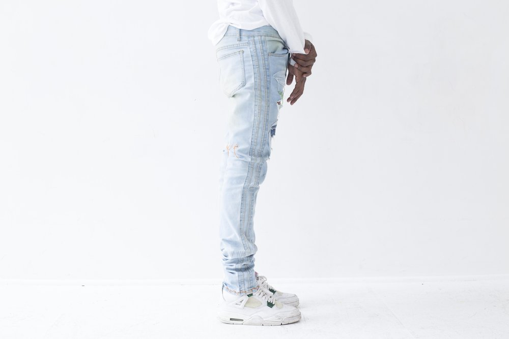 nextlvlhigh scab jeans on body side.jpg