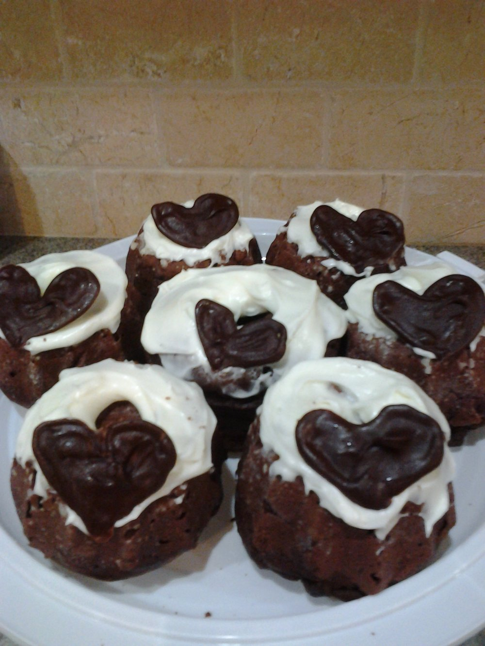 CHOCOLATE CAKE WITH WHITE FROSTING AND CHOCOLATE HEART