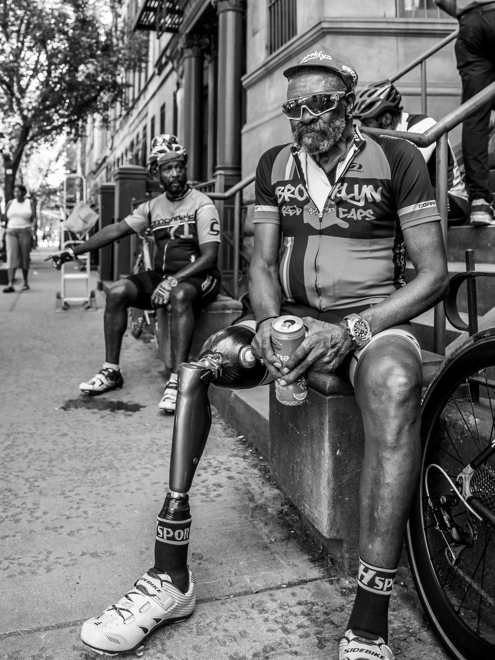 Once a cyclist, always a cyclist. This spectator came out with his cycling friends to watch the races at a local criterium event in Harlem, New York City.