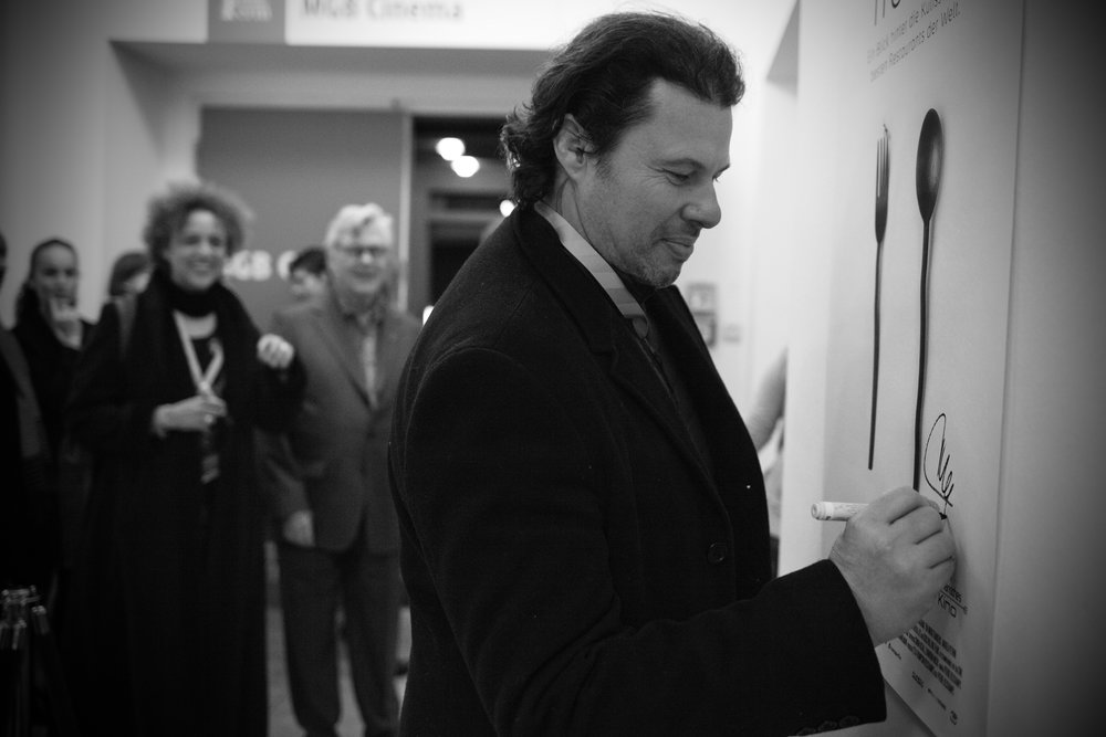 Signing Noma's poster at the Berlinale