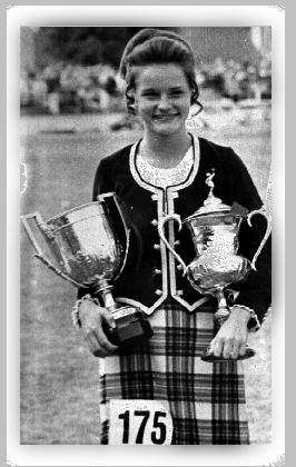 Mary Beth holding the Scottish Championship   and Juvenile World Championship trophies.   Cowal, Scotland 1976