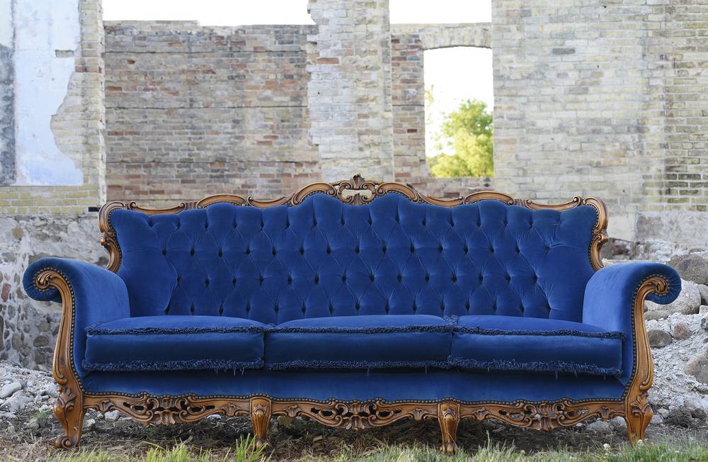 Pierre blue sofa by Relics Vintage Rentals.Location by Dream Apple Farm.