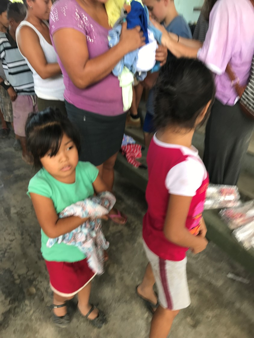 Passing out clothes to impoverished families
