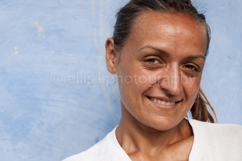 Portrait of a young beautiful gipsy mother. Looks innocent and cute in the camera. Daily life photographer Ellis Peeters