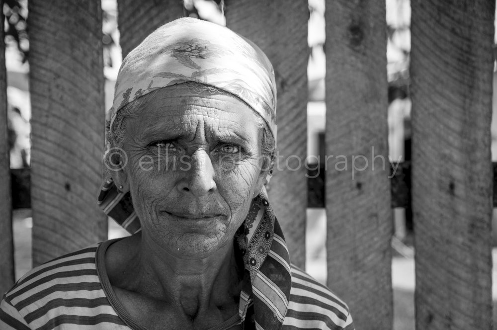 Romanian gipsy grandma. Black and white daily life portrait of an old beautiful woman.Part of the series Portraits of a Romanian Family by Ellis Peeters Photography