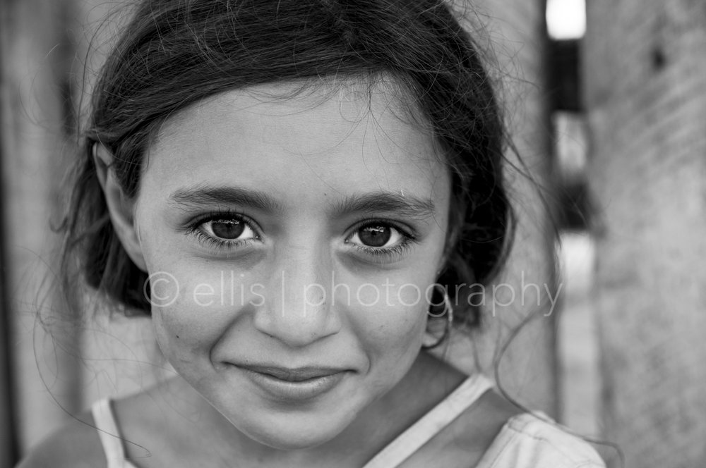 Young cute gipsy girl with beautiful big eyes. Part of the series 'portraits of a romanian family'.