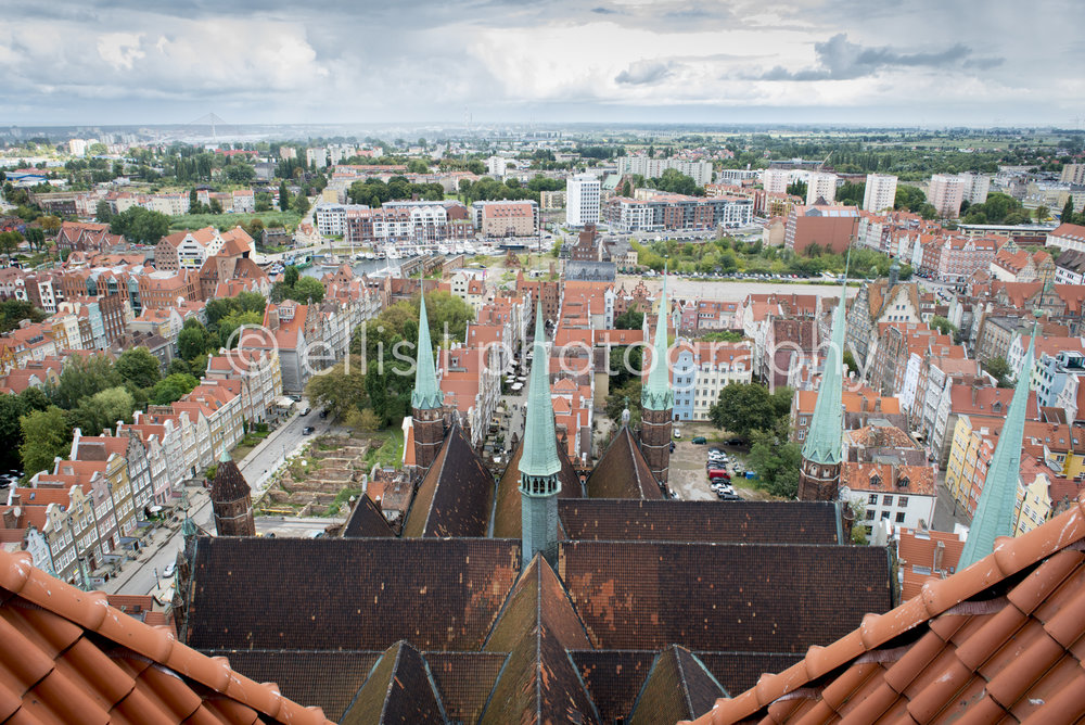 Lookout from the St. Mary's Church of Gdansk, Poland. View over the old city. Houses with Dutch architect style. Ruins from world war 2. Harbor of Gdansk visible.Basilica of the Assumption of the Blessed Virgin Mary. One of the largest brick churches in the world.