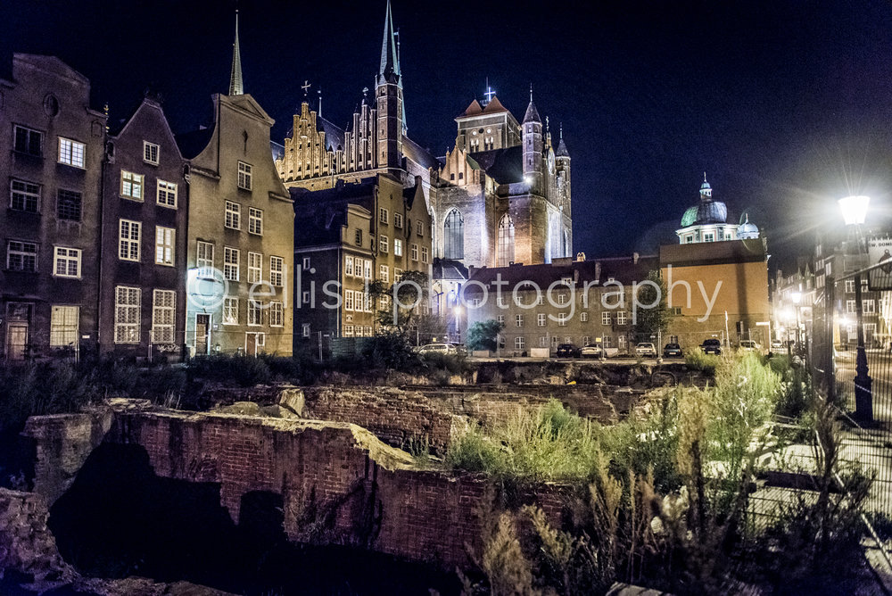 World war 2 ruins in Gdansk, still visible. In the back the oldest brick church of the world, st. mary's church. Photograph taken by Ellis Photography.