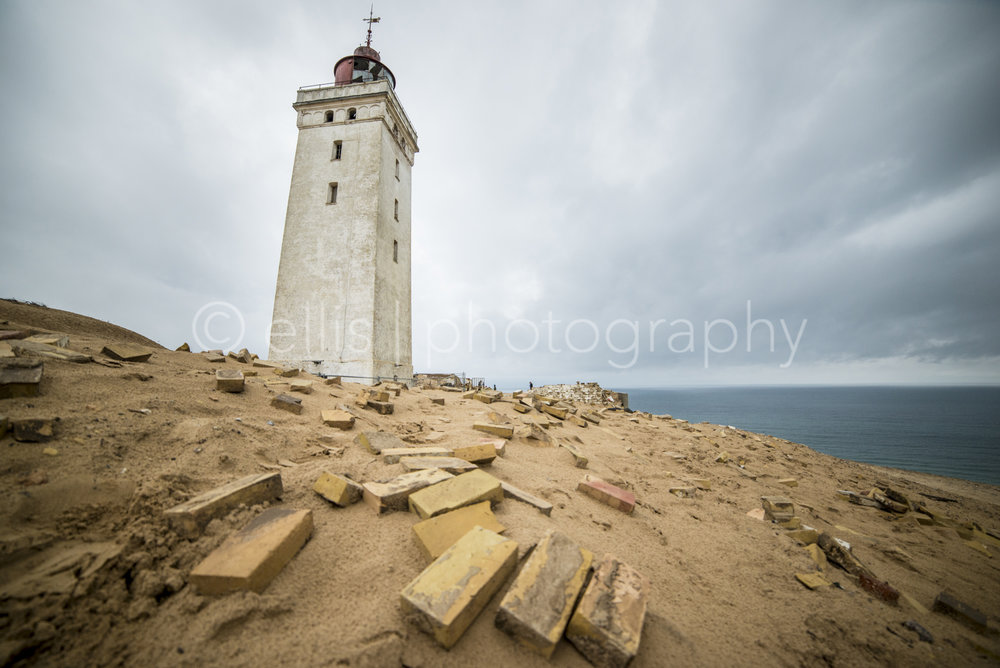 Rubjerg Knude fyr lighthouse. Dark, dramatic sky with bricks in front. Northsea. Ellis photography