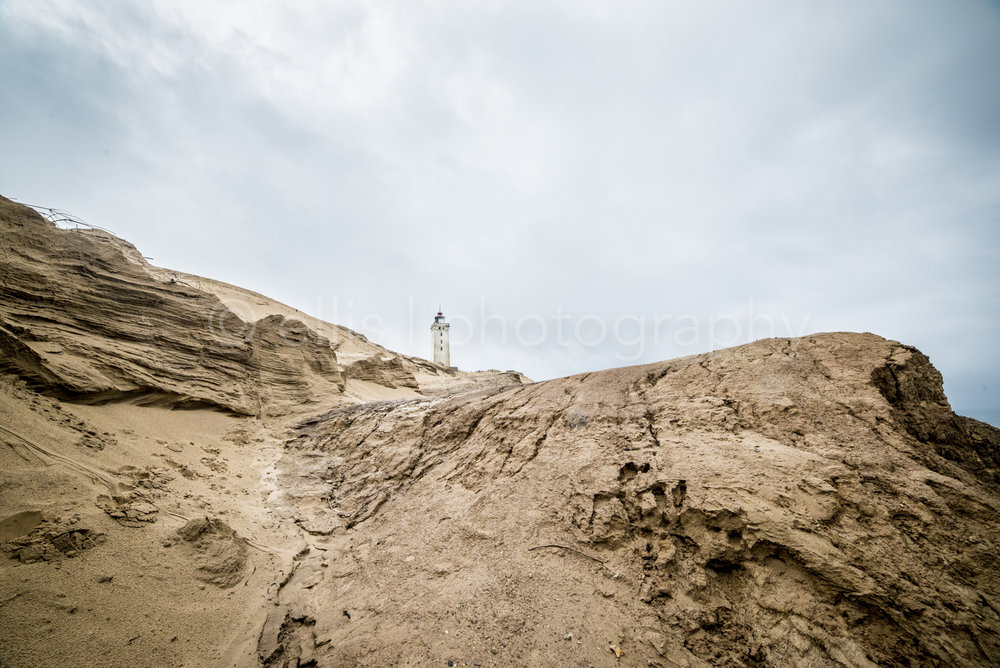 Dramatic photo of the lighthouse of Rubjerg fyr in Denmark. Dramatic dunes. Photo taken by Ellis Photography