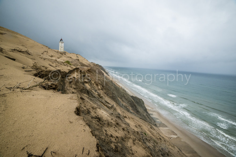 Rubjerg Knude Fyr Lighthouse Denmark. Nikon wideangle shot for a dramatic look. Big, high dunes and a wild ocean. Travel Ellis photography