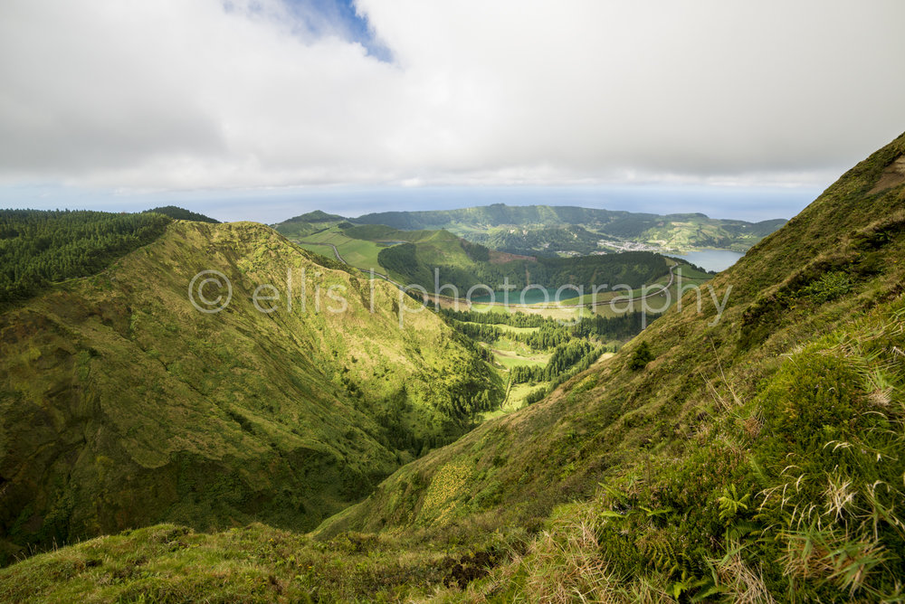 View on the lakes of Sete Didades. Between the green mountains, in the valley you see the lake and the end of the island of Sao São Miguel, Azores.
