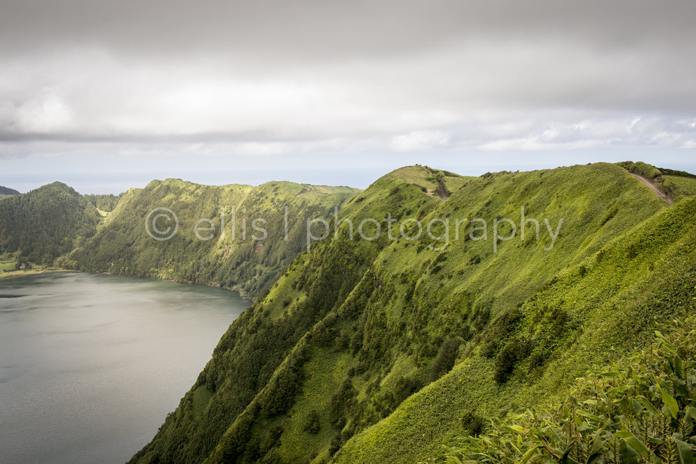 Beautiful steep green mountains that set the boundaries for the lakes of Sete Cidades. Photograph taken by Ellis Photography