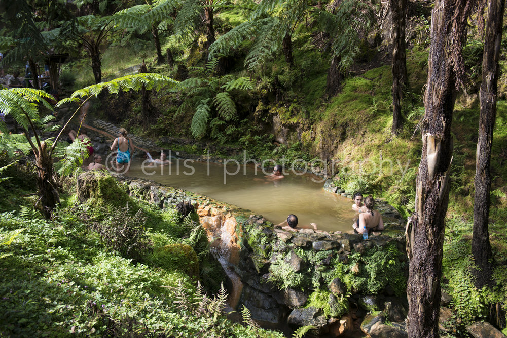 People are enjoying the natural hot spring in the middle of the island of Sao miguel, at Caldeira Velha. Ellis photography