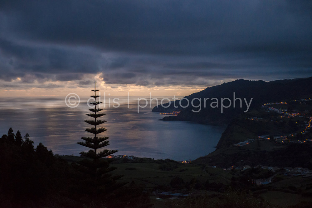 View over the city of Faial da Terra, island of Sao Miguel. Ellis photography took this picture. Mountains look like a crocodile with the sunset.