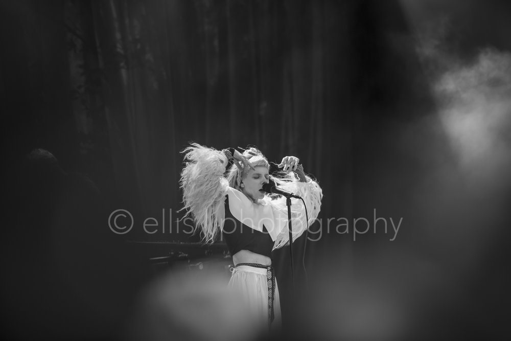 Aurora Aksnes, singer songwriter from Norway, great performer and lovely sweet girl, sings beautifully on the festival of Træna Trena. Black and white concert photo taken by Ellis Photography