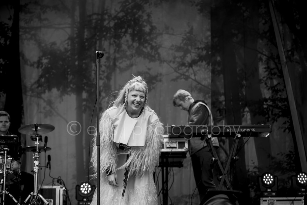 Aurora laughing during her show on the Trena festival in Northern Norway. Black and white concert photograph from Ellis Peeters Photography