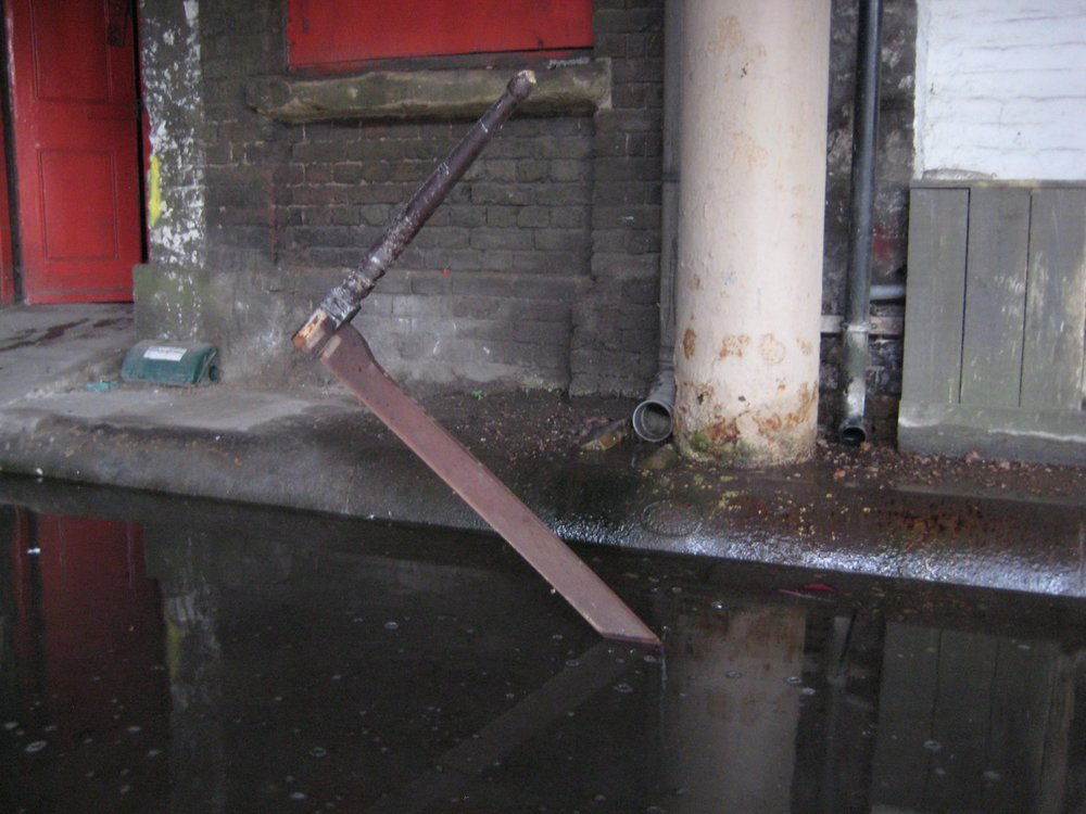 XLIII Table in drain (submerged).jpg
