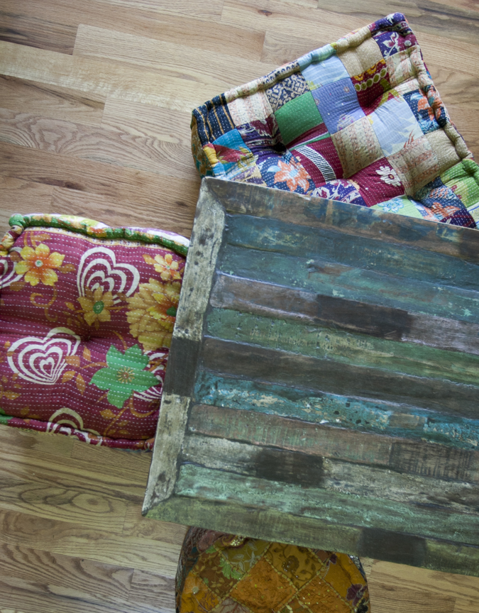 A bohemian pop of color can also easily be stored under the coffee table