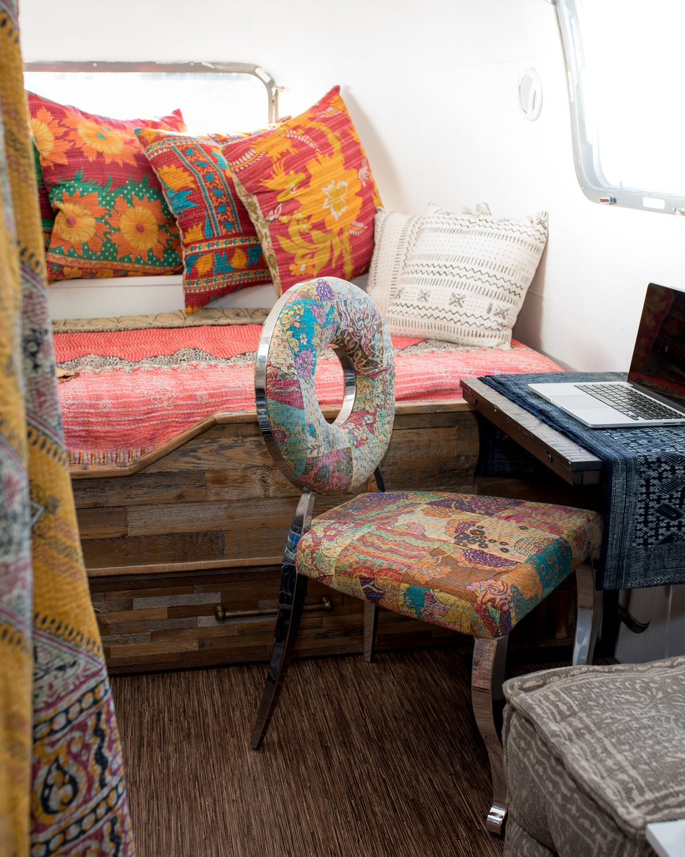 """We switched it up slightly in this picture to feature the coolest looking """"donut chair"""" ever. We use vintage indian fabric for the upholstery to give it that special bohemian funky pop of color."""