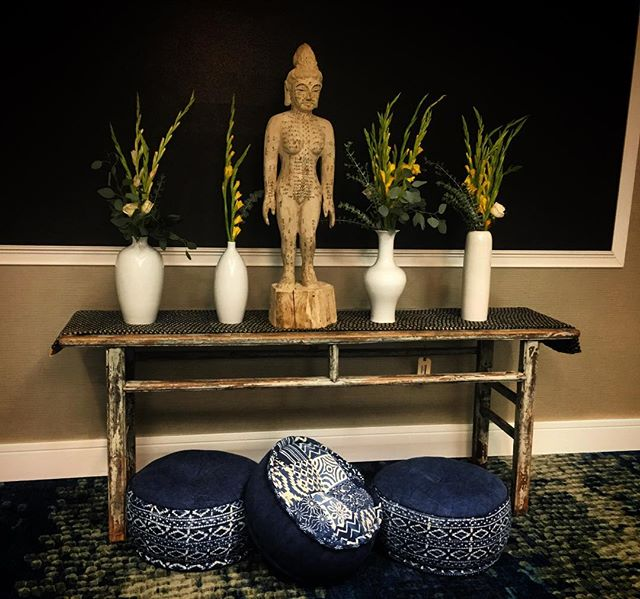Beginning to set up altars for @ashevilleyogafestival! This one is in the @hiltongardeninn. Who is coming into town for the #ashevilleyogafestival?  We are excited to connected with so many yogis! . . . . . . . . . #ijustwanttodoyoga #yogainspiration #yoga #yogi #accupuncture #enjoylife #begrateful #happyliving #asheville #ashevilleyoga #everythingisforsale #altar #boho #showmeyourboho #bohostyle