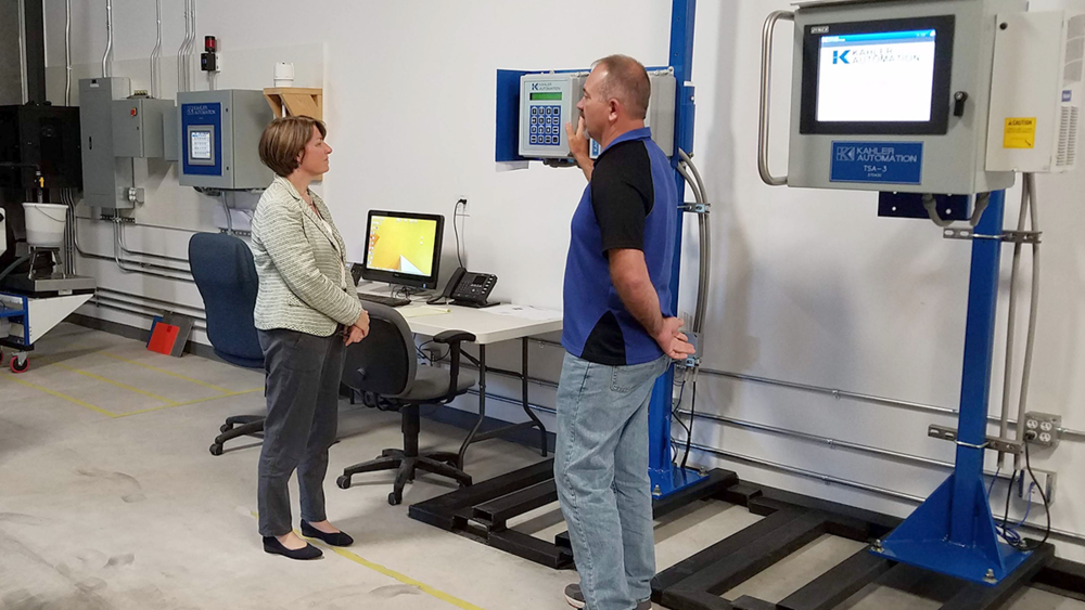 Engineer Paul Rehm begins to explain the elements of Kahler's truck traffic control system to Sen. Klobuchar.