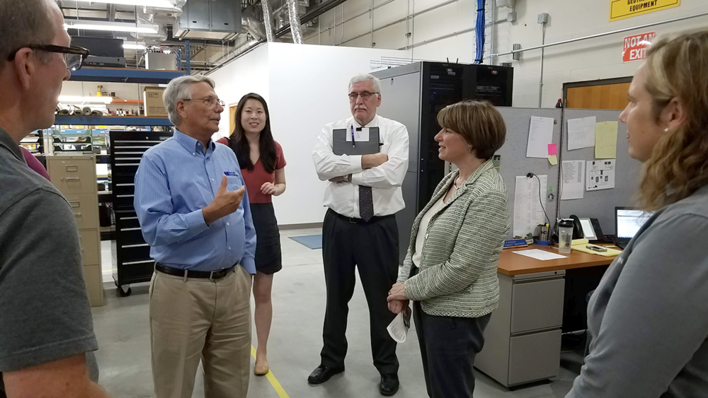 Wayne Kahler talks to Sen. Klobuchar about the role of aircraft, and rural airport infrastructure, in Kahler Automation's business model.