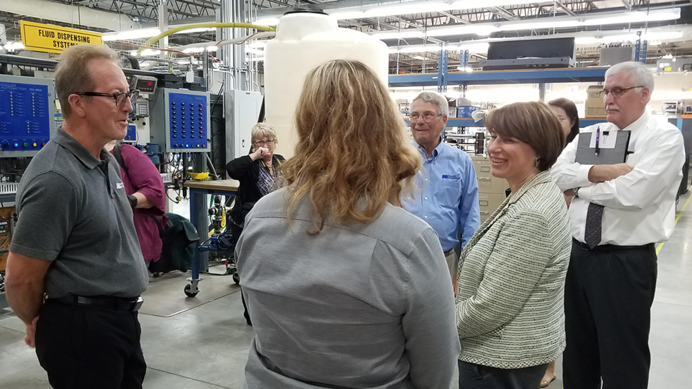 Sen. Klobuchar shares a light-hearted moment along the Kahler Automation tour.