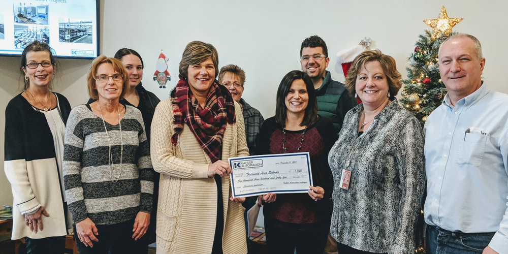 "FAIRMONT AREA SCHOOLS ACCEPTS CHECK FROM KAHLER AUTOMATION'S ""BISON COMMITTEE"" MEMBERS — L-R:Martha Myren, Norma Seibert, Megan Hancock, Courtney Cutler, Darla Mammenga, Fairmont Area Schools school social worker Michelle Thompson, Max Haake, Fairmont Area Schools dean of students Traci Lardy, and Brian Enstad."