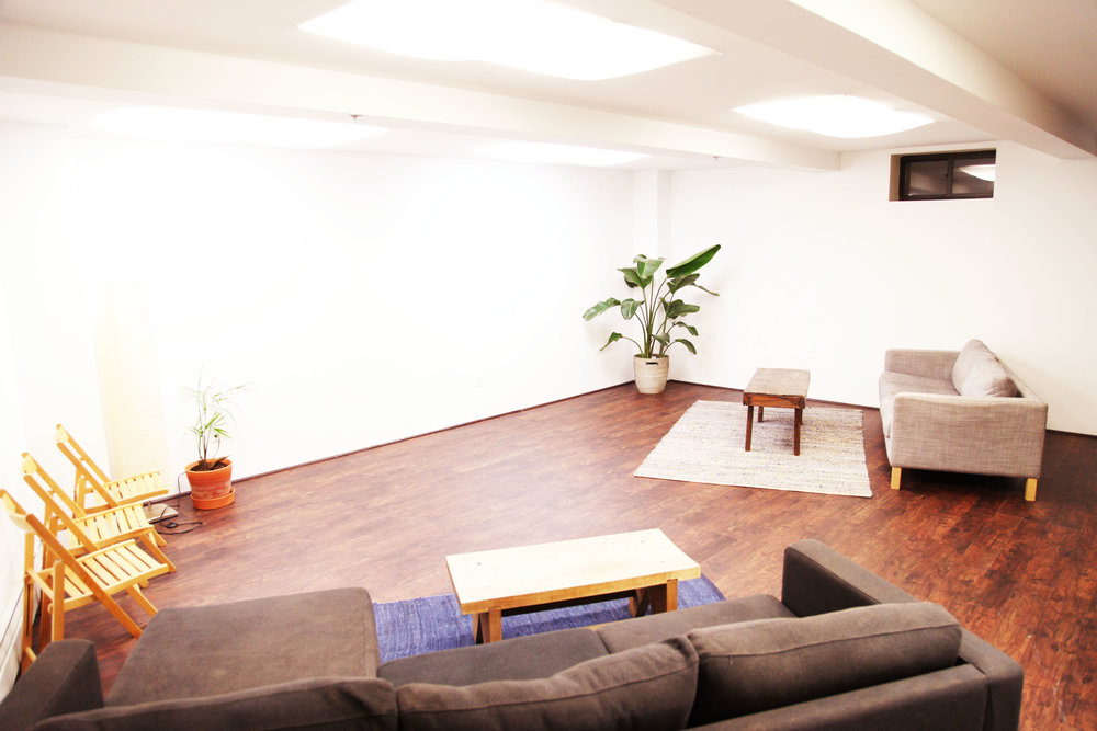 Basement Level studio designed for intimate performances, screenings, circle meetings and wellness offerings.