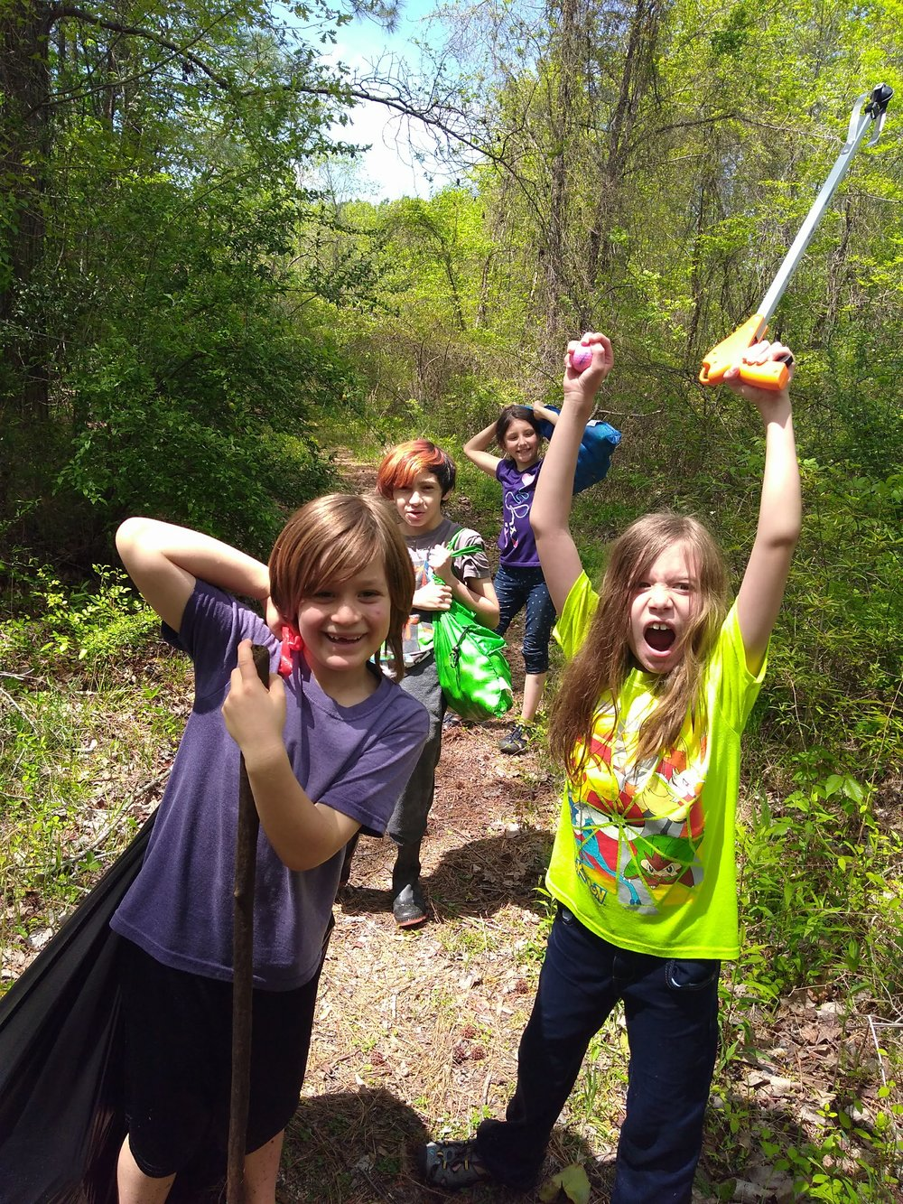 Pathfinder kids picking up trash, author's daughter front right.