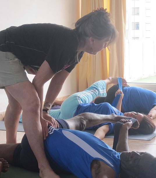 Mary Paffard Adjusting students in yoga — Holguin and Habana 2014