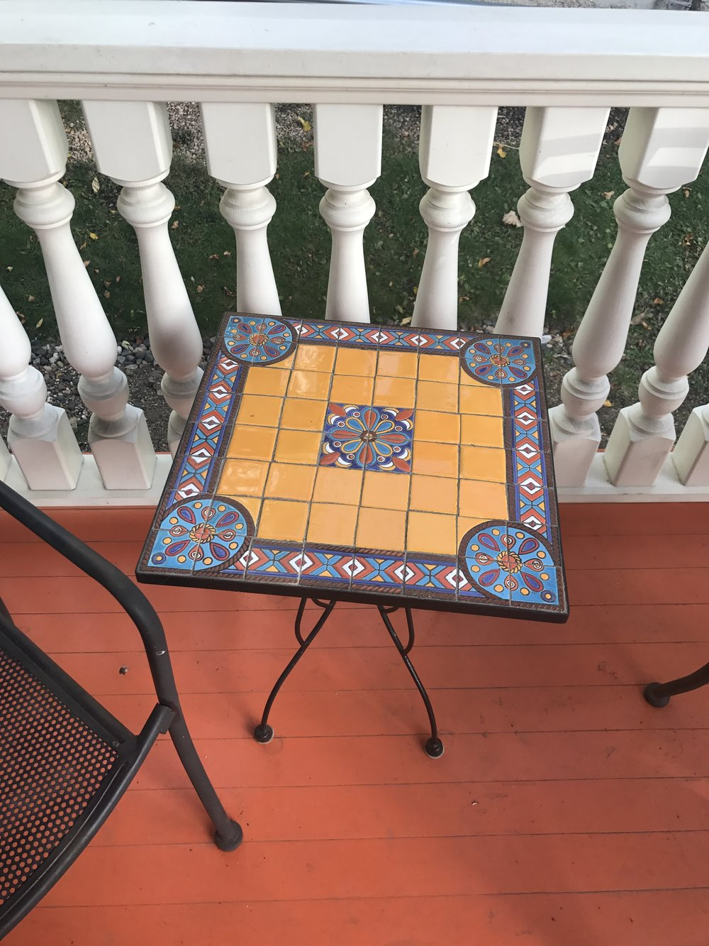 Theresa chose bright colors for her porch, inspired by a trip to Spain with her family.