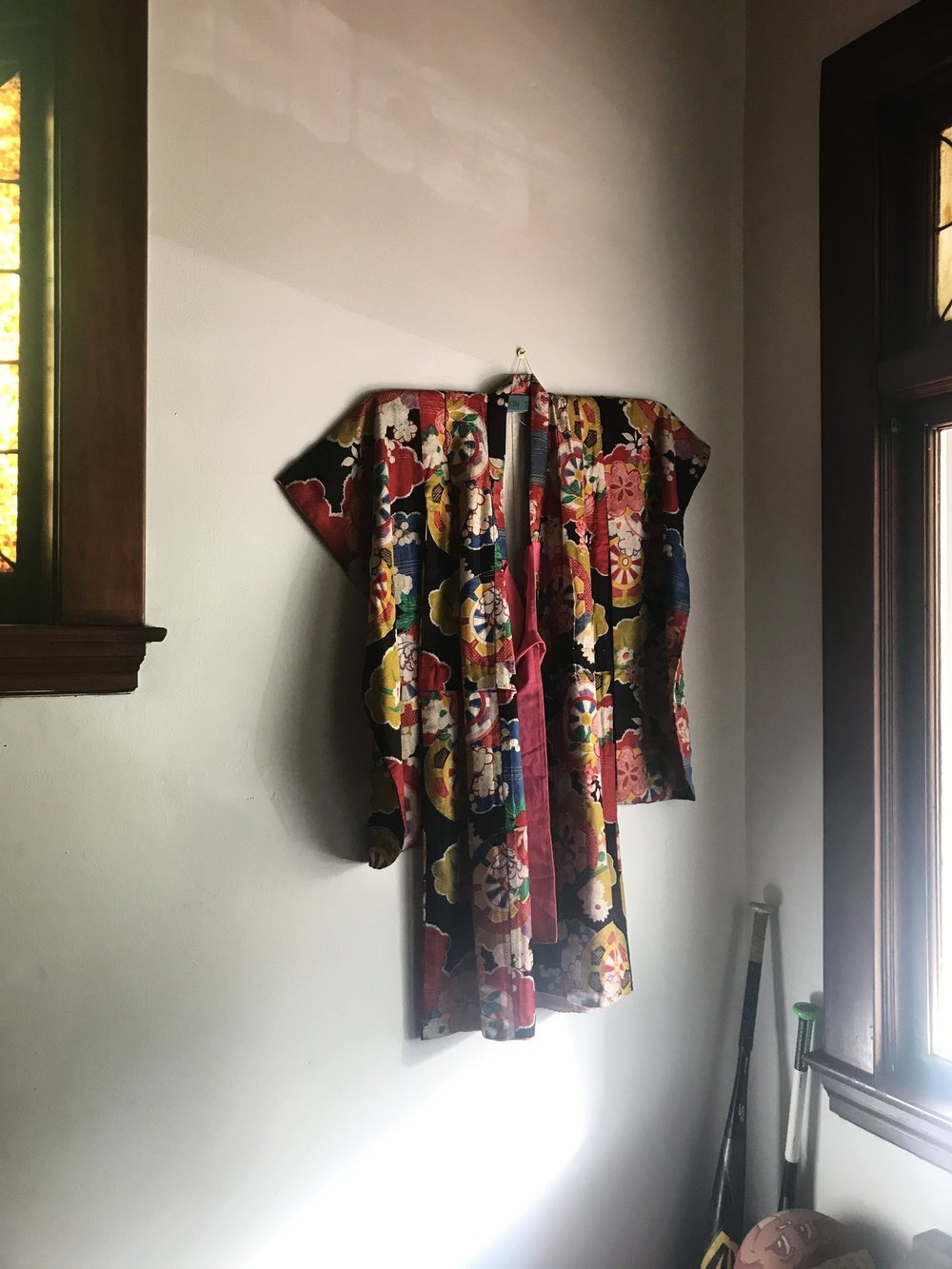 Theresa has two sons, so naturally there are baseball bats and other signs of life displayed amongst treasures like this kimono from the family's year living in Japan.