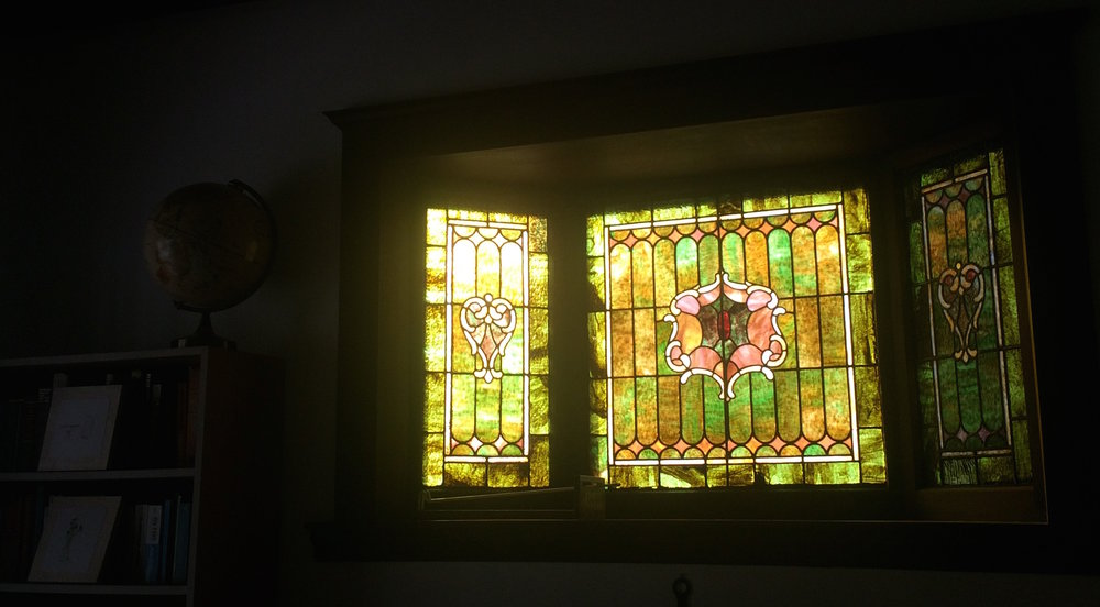 The original stained glass windows also persuaded the couple to purchase their home. Theresa's incorporated the green into her paint and decor choices!