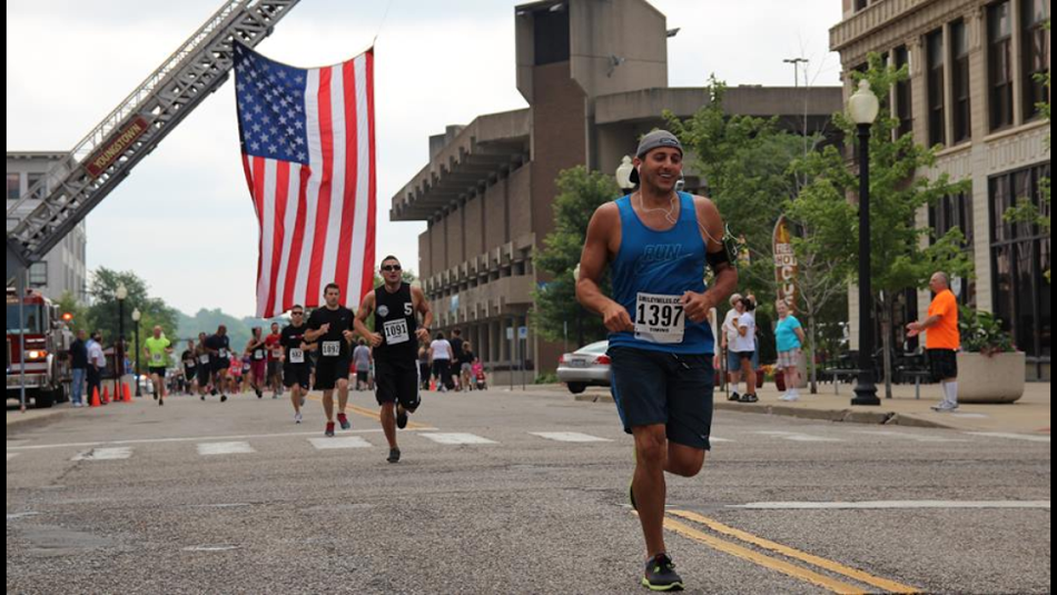 Runners under the US Flag.png