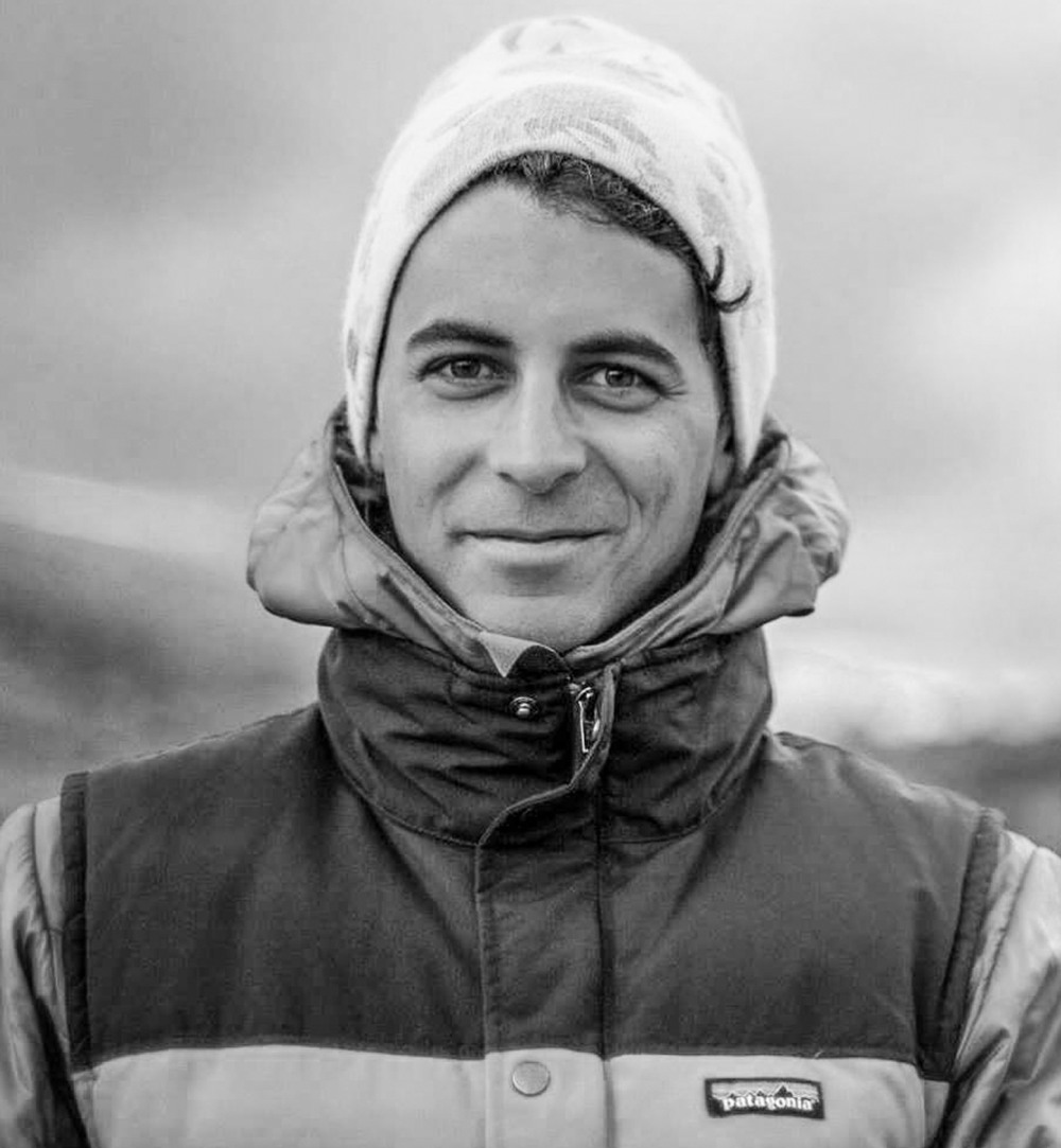 Davide De Masi //Producer - Director   Davide's story is one of transformation and passion. Raised in Park City, UT, Davide became deeply involved in adventure sports from a young age.His interest in sustainability and passion for the natural world lead him to pursue a graduate degree in environmental engineering in Switzerland where he eventually ended settling in among the jagged peaks of the Chamonix Valley in France.  Losing his fiancé in an avalanche in 2014 catalyzed a professional pivot for Davide, who felt compelled to re-engage with his propensity for artistic exploration and film-making in the vertical world. He now devotes himself entirely to capturing and sharing human moments that encourage the pursuit of a meaningful life, which allows him to draw upon his academic background in ecology, technical outdoor skills, and media production experience.
