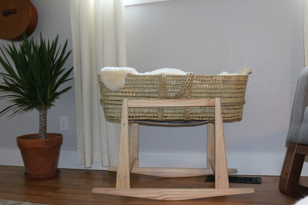 Palm Leave Moses Basket with Handles from Wayfair, Jolly Jumper Rocking Moses Basket Stand from Bed Bath & Beyond,Home-made curtains,Wayfair rocking chair.)