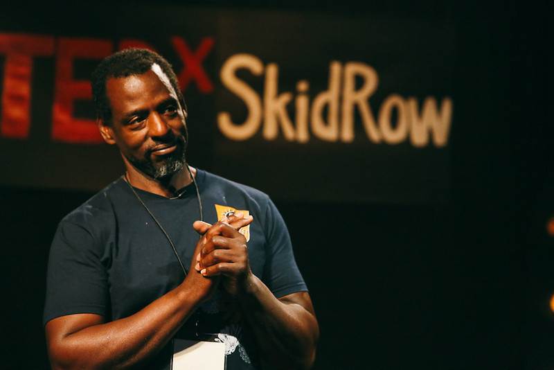 "Ron Finley, speaking at TEDxSkidRow2013, ""Mirroring Los Angeles"". Co-hosted by the 24th Street Theatre and Street Symphony, we aim to celebrate the passion, drive and brilliance of activists within our own community. These Social Warriors mobilize communities, serving as wellsprings of advocacy and transformation. Our embedded activists challenge and redress social issues within our own city knowing that we can best enact our vision for global change most effectively in our local setting FIRST."