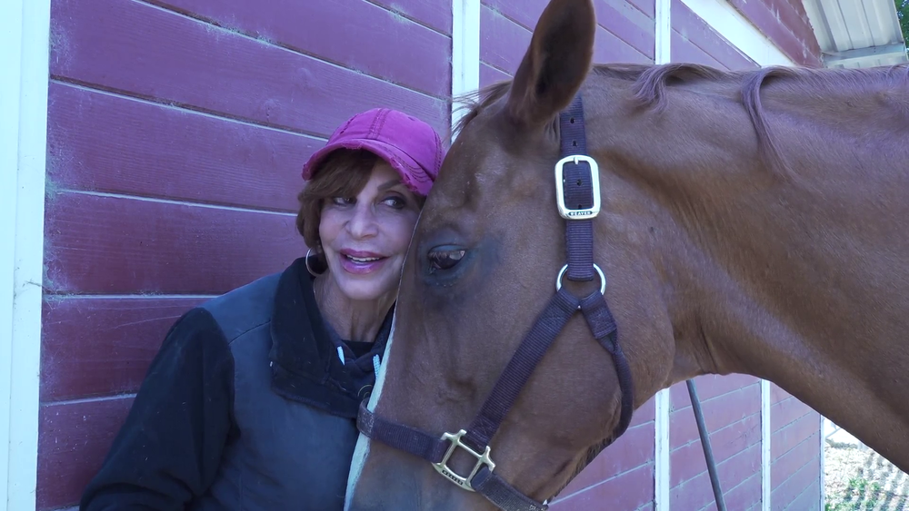 Our director Linda and her lucky number SEVEN.  A still image from the upcoming documentary HIGH-SENSITIVE YOUTH IN THE HORSE-HEART SPACE. by Jolanda Ellenberger . See our events page for more information.