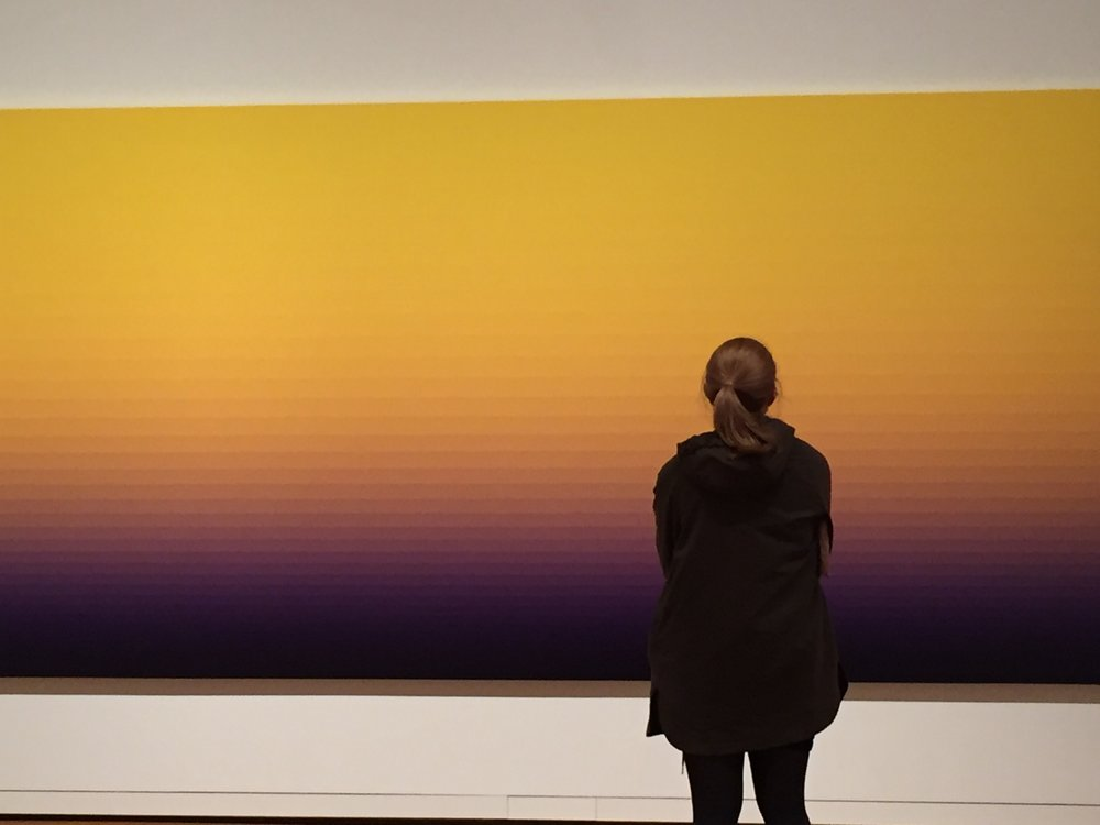 A woman gazing at artwork.