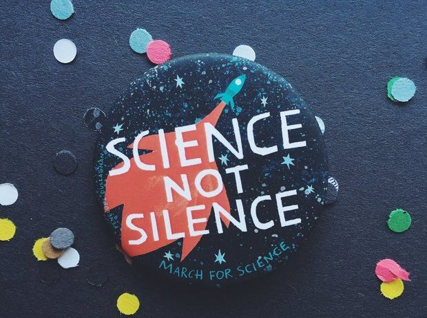 "Pins and posters featuring the message ""Science, Not Silence,"" designed by Indianapolis artist Penelope Dullaghan for Pincause, will be a familiar sight at more than 500 March for Science events worldwide on Saturday, April 22. (Courtesy of Pincause)"