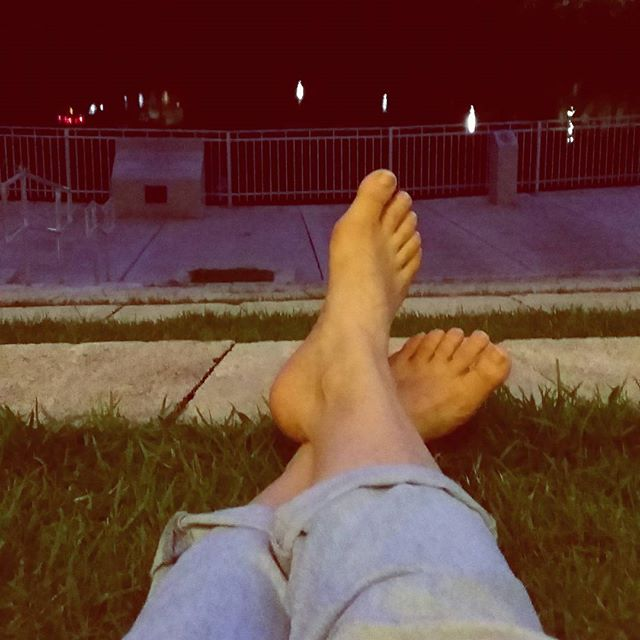 Relaxing on the grass. Meditating on life. Waiting for the hurricane to pass. Surround yourself with love.