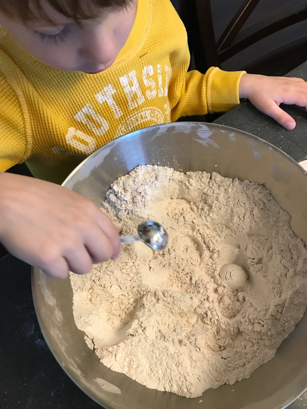 My little helper mixing the dry ingredients.