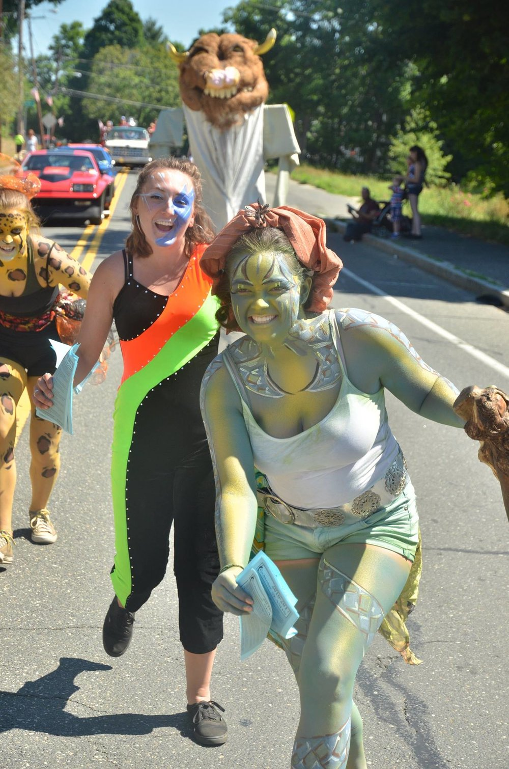 Mariah Waite, Emily Tyburski, and Holly Cote, run from the Wild Things at Summerfest!
