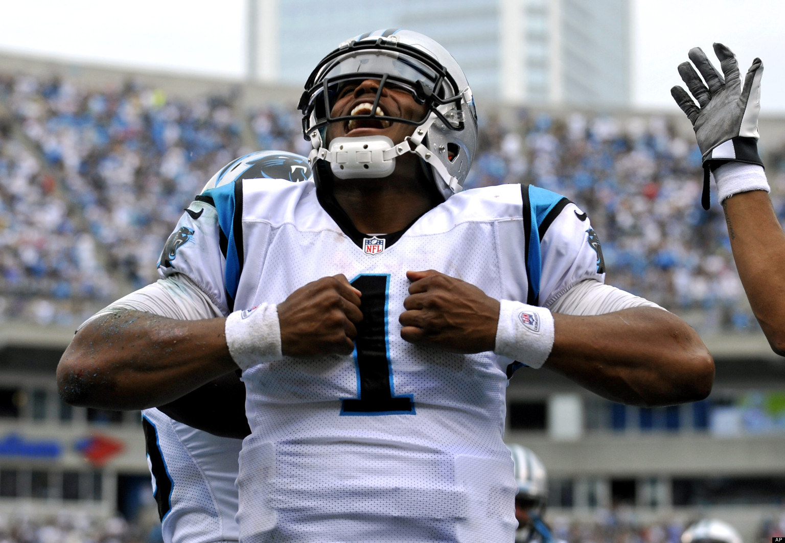 bf716e656 Carolina Panthers  Cam Newton (1) reacts after running for a touchdown  against the New Orleans Saints during the fourth quarter of an NFL football  game in ...
