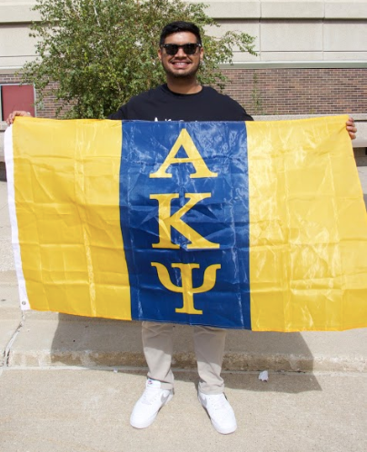 Brother Ahmed proudly holding up the Alpha Kappa Psi flag!