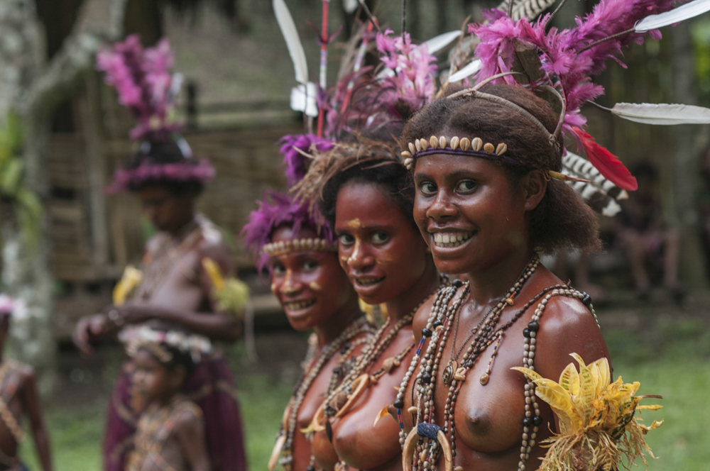 The local women of the Madang Province in traditional handmade dress.
