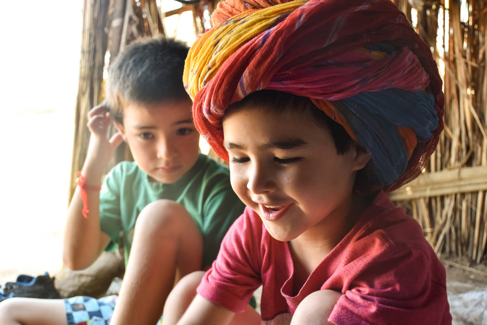 The kids visiting a local's hut in the Rajasthani desert.