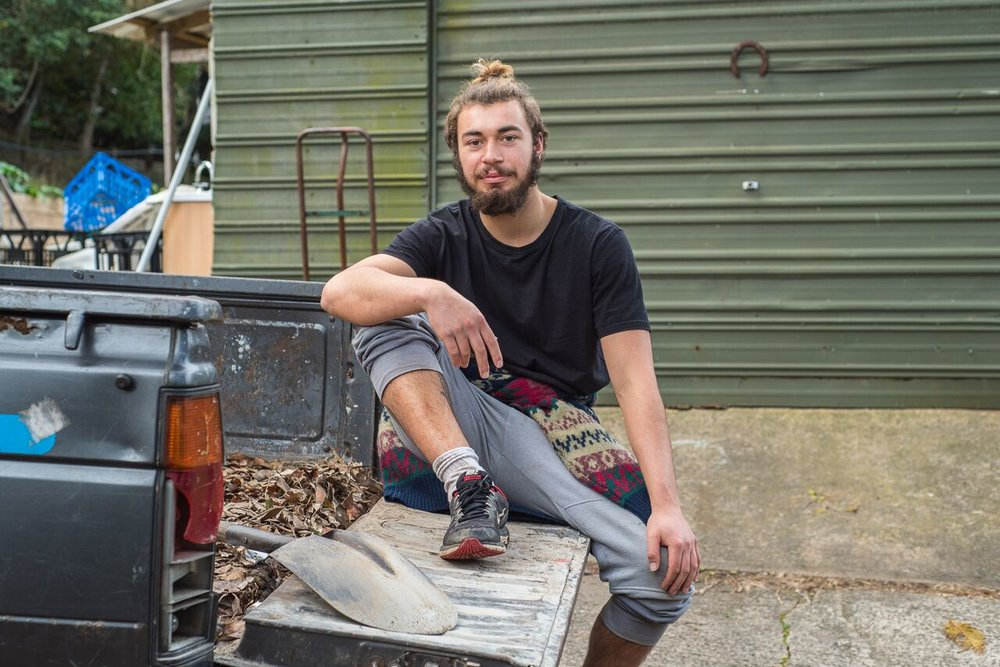 Ethan (Australia) helping with maintenance